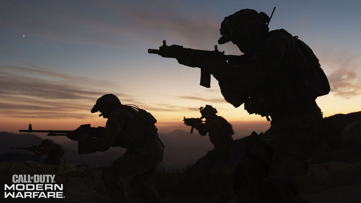 A group of heavily armed soldiers walk in front of a sunset
