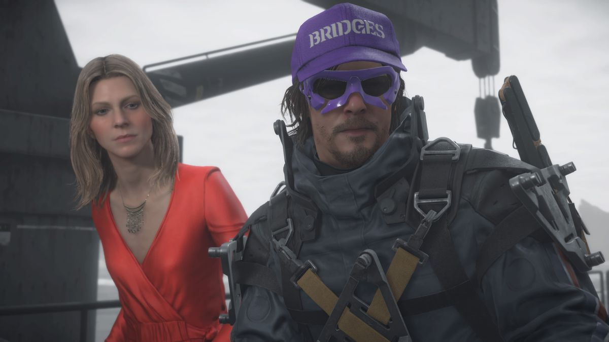 "a middle-aged blond woman in a red dress standing next to a man in a futuristic spacesuit wearing a purple hat that says ""BRIDGES"" and purple-rimmed sunglasses, in Death Stranding"