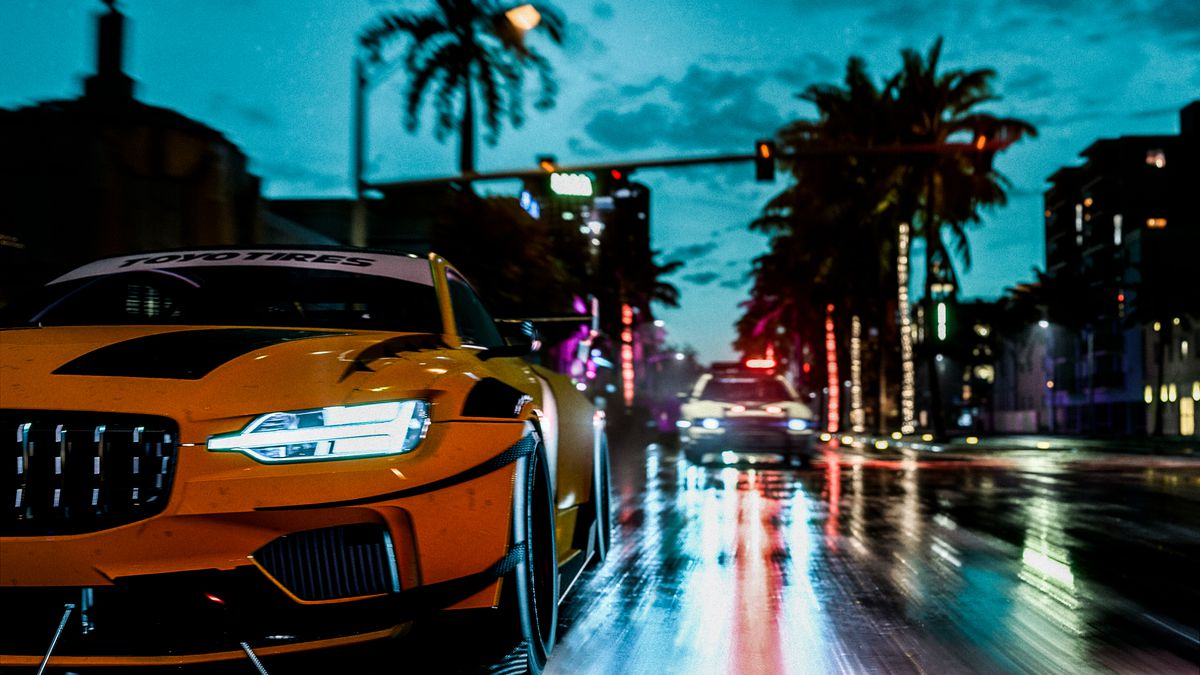 A tricked-out street racer plows down a wet street lined with palm trees in Need For Speed Heat