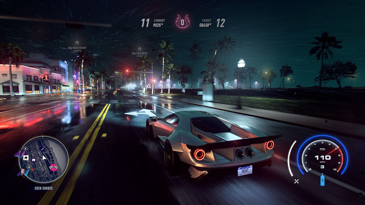 In-game shot of a high-performance racing car mowing down wet city streets in Need For Speed Heat