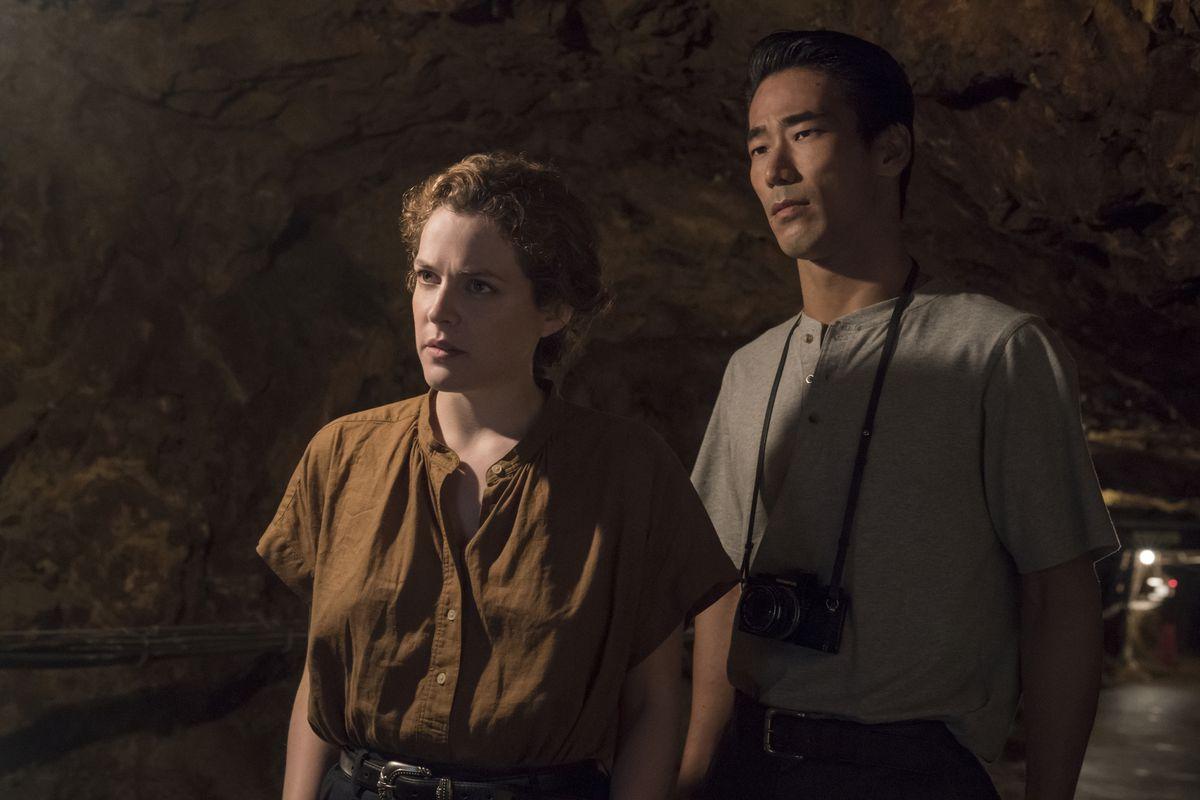 Lily (Keough) and Teiji (Kobayashi) both look concerned.