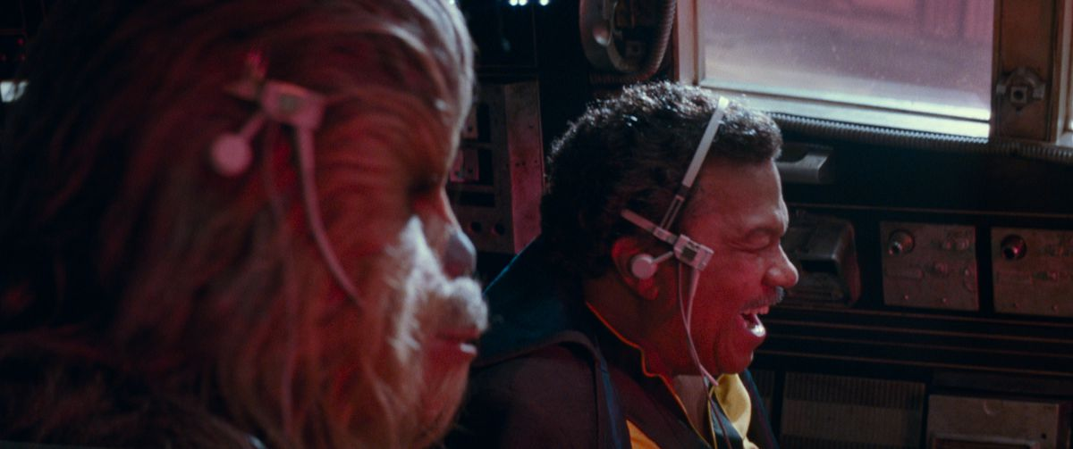 Chewbacca and Lando Calrissian fly the Millennium Falcon into battle in Star Wars: The Rise of Skywalker