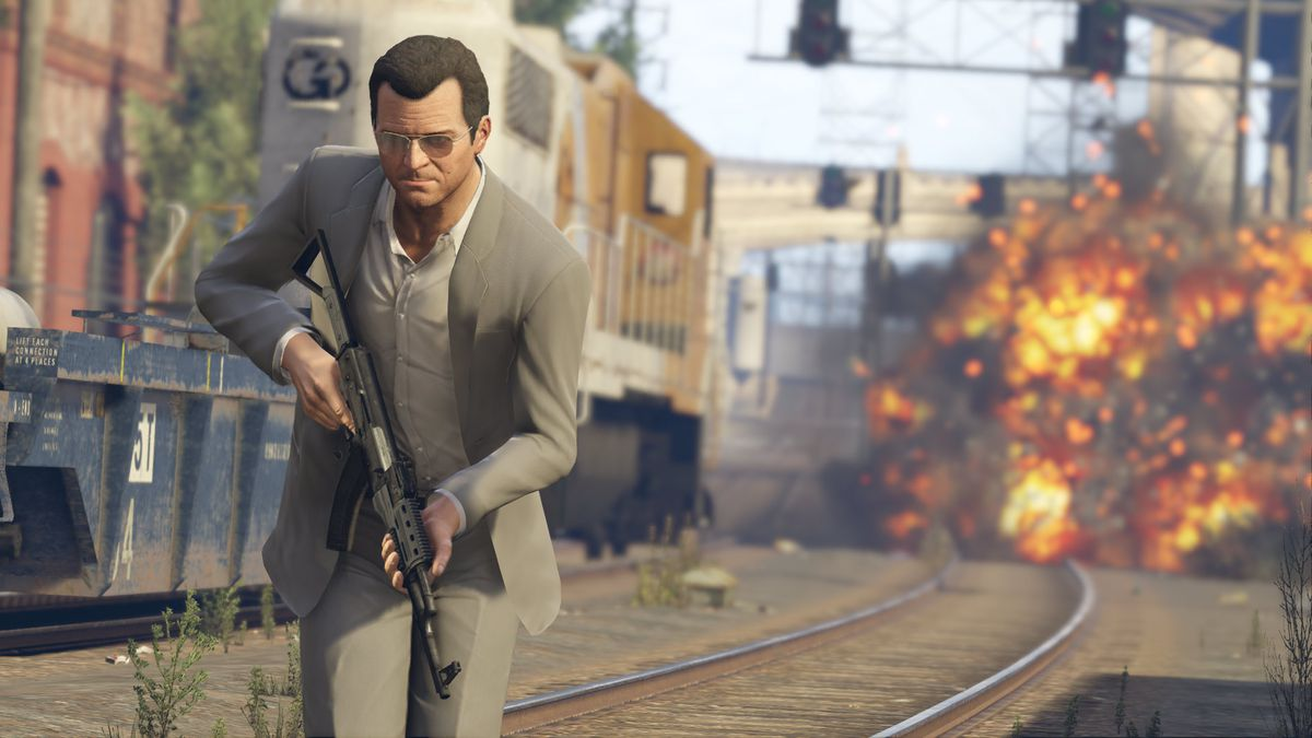 a man in a suit walking with an assault rifle in Grand Theft Auto 5