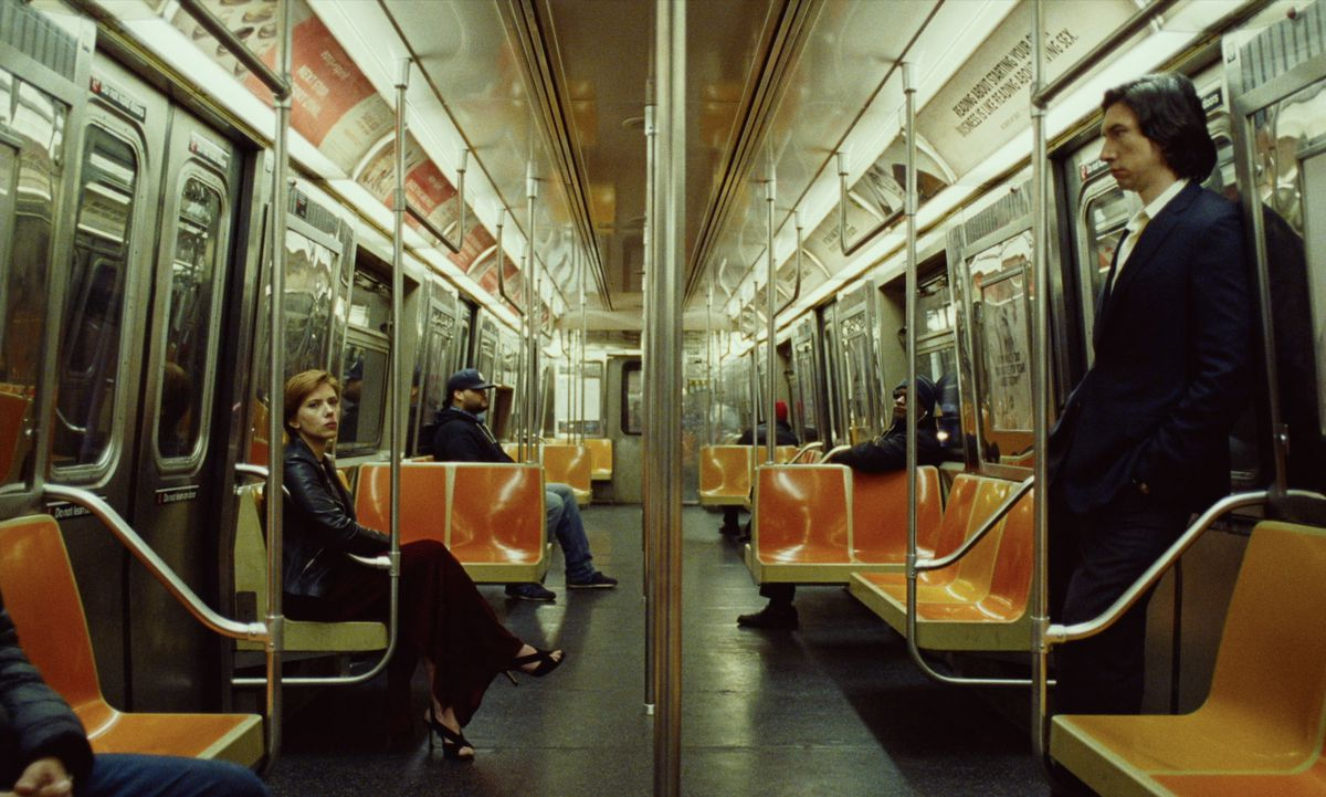 Johansson and Driver across from each other in a subway car.