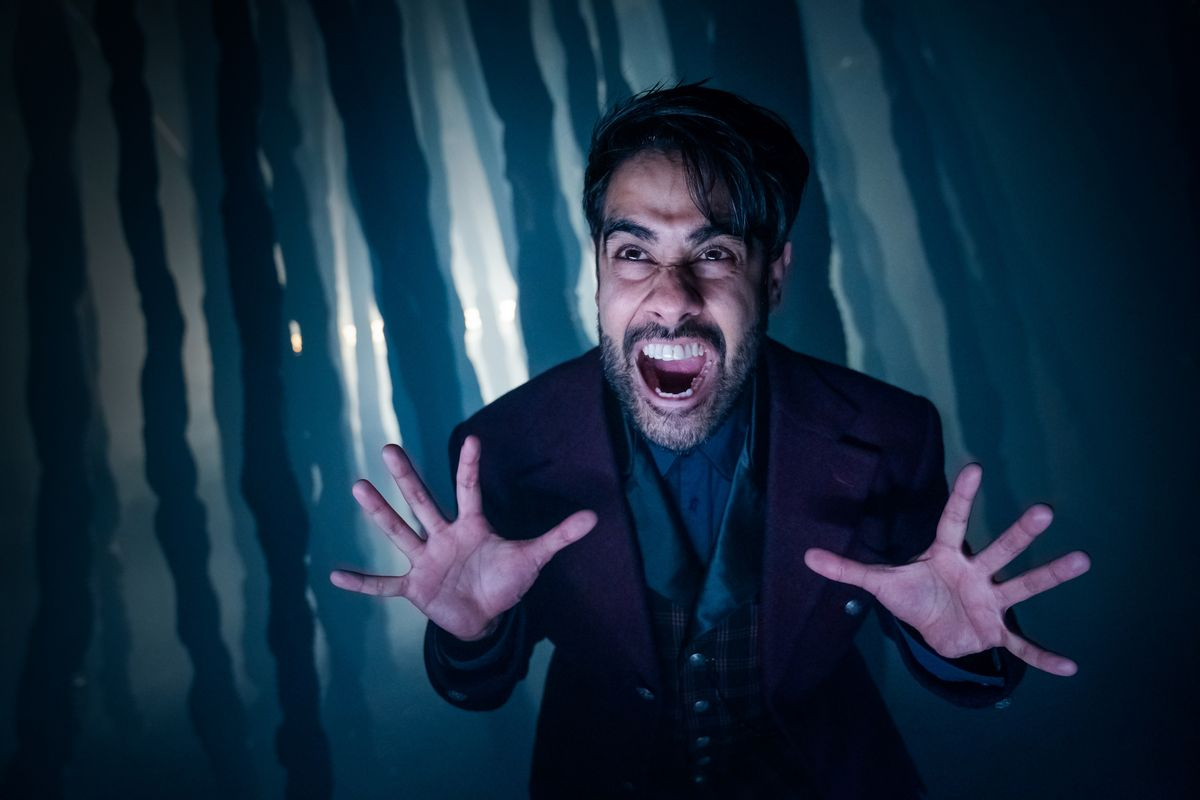 Sacha Dhawan as O in Doctor Who, snarling with a distorted face and extended hands.