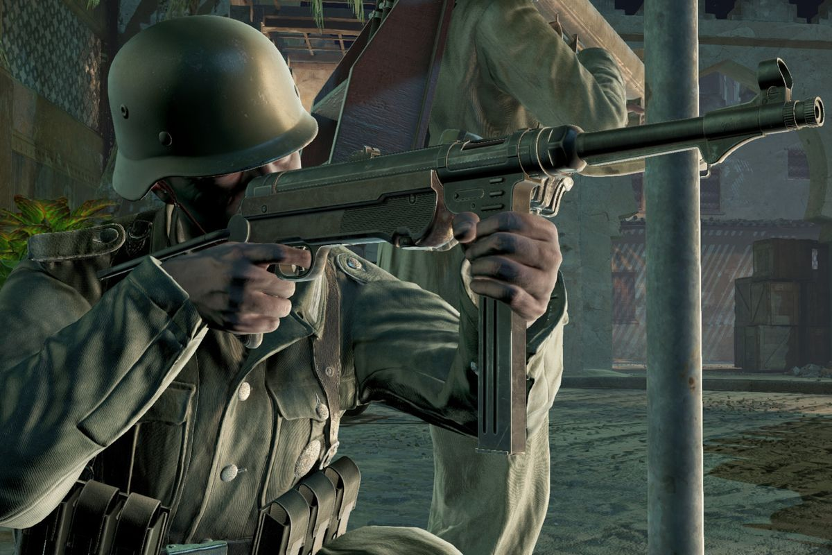 A German soldier in WWII lines up a shot with an MP-44. Behind him is another soldier with a Panzerfaust.