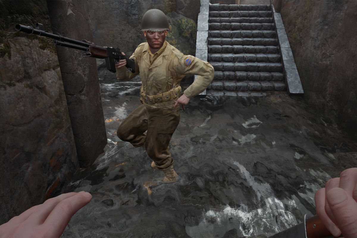 An American soldier in WWII reloading a BAR as he stands in a sewer.