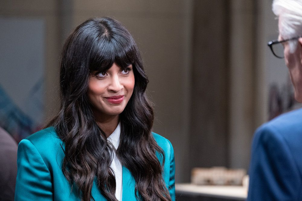 "Tahani (Jameela Jamil) smiles at Michael (Ted Danson)  in a screenshot from The Good Place season 4, episode 13, ""Whenever You're Ready"""