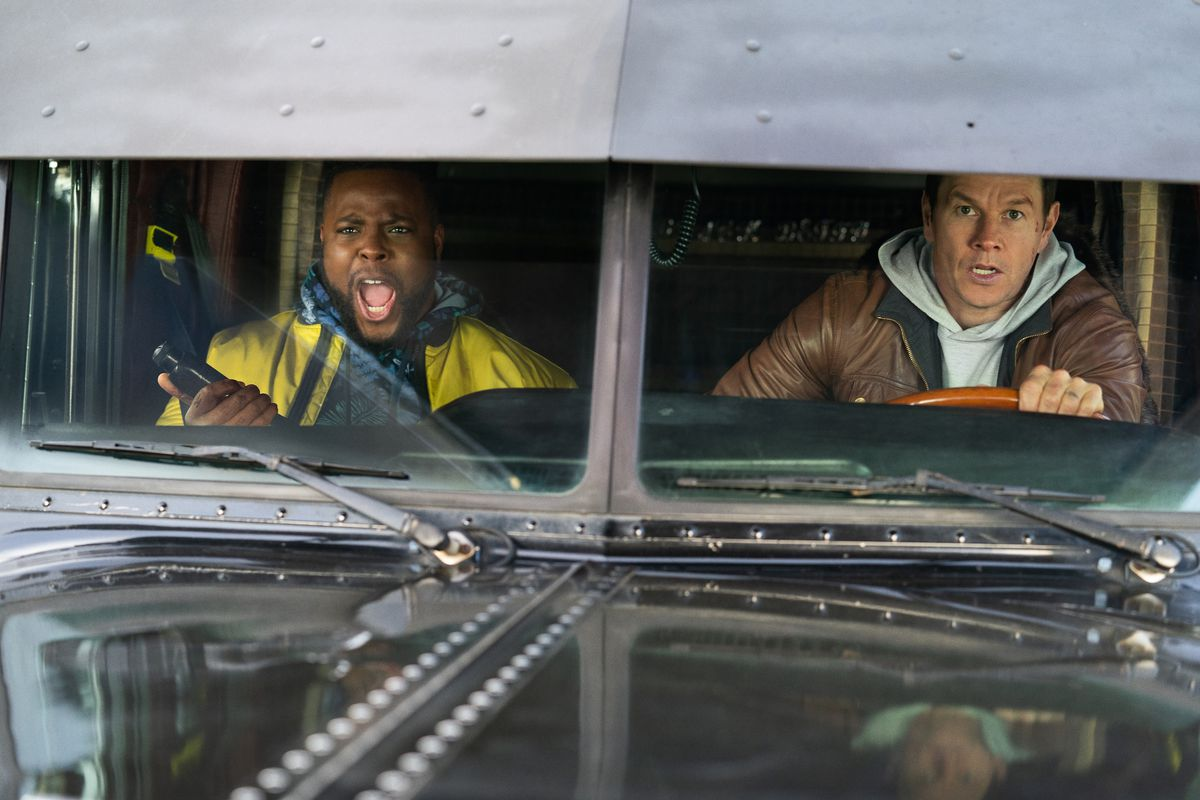 Wahlberg drives a truck as Duke, in the passenger seat, yells.