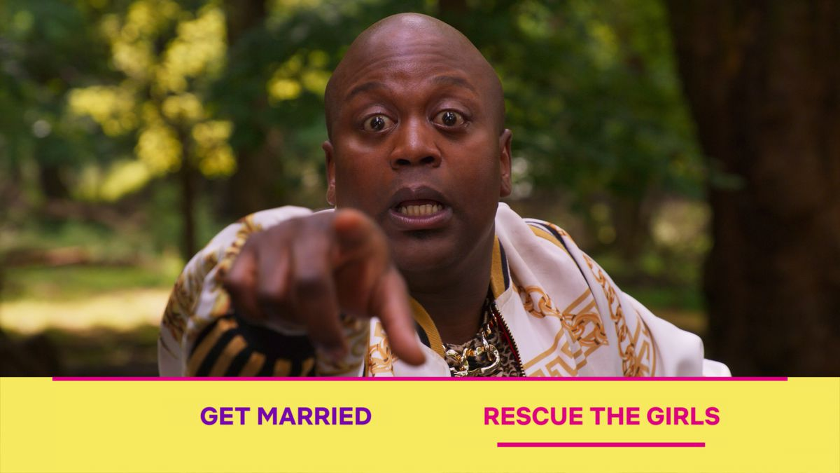 "Tituss Burgess points at the screen with his eyes bugged out as Netflix's Kimmy Schmidt interactive special asks viewers to choose between ""Get married"" and ""Rescue the Girls."""