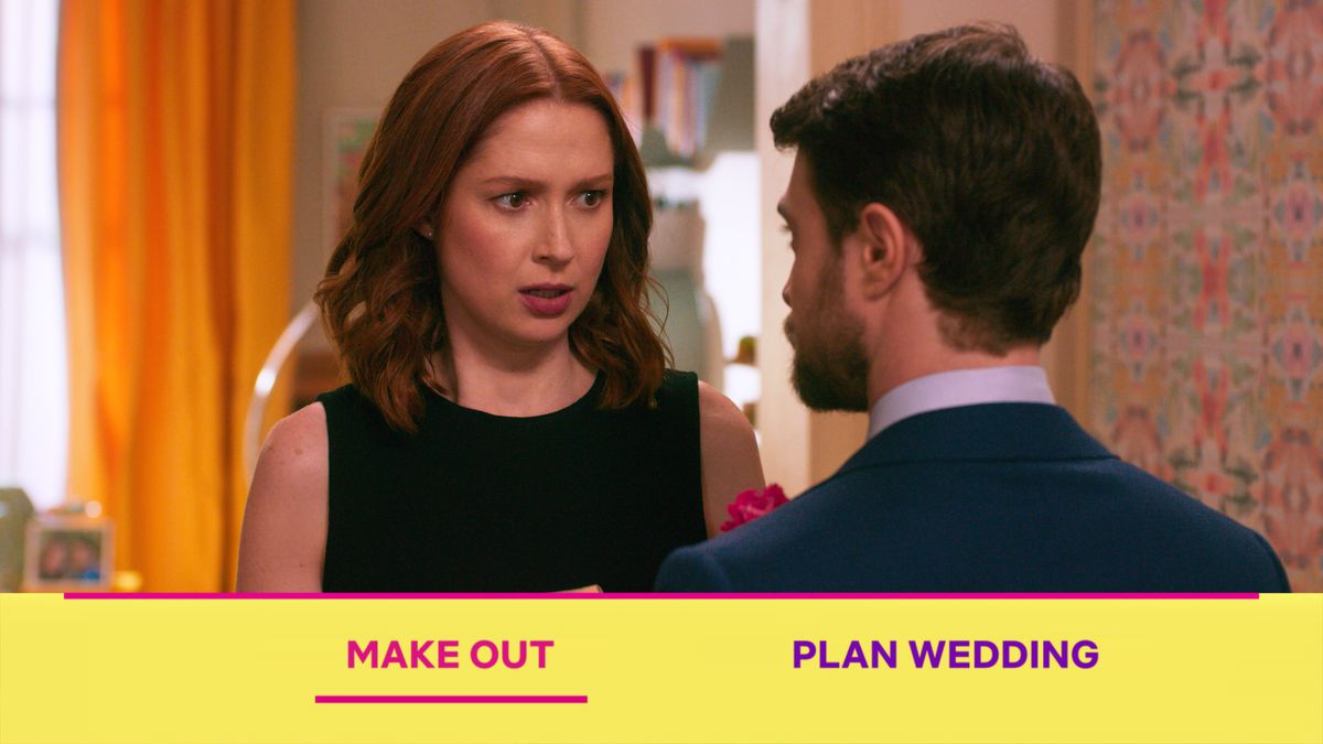"Ellie Kemper looks at Daniel Radcliffe in the Unbreakable Kimmy Schmidt interactive special, as the viewer is asked to choose between ""Make out"" and ""Plan wedding."""