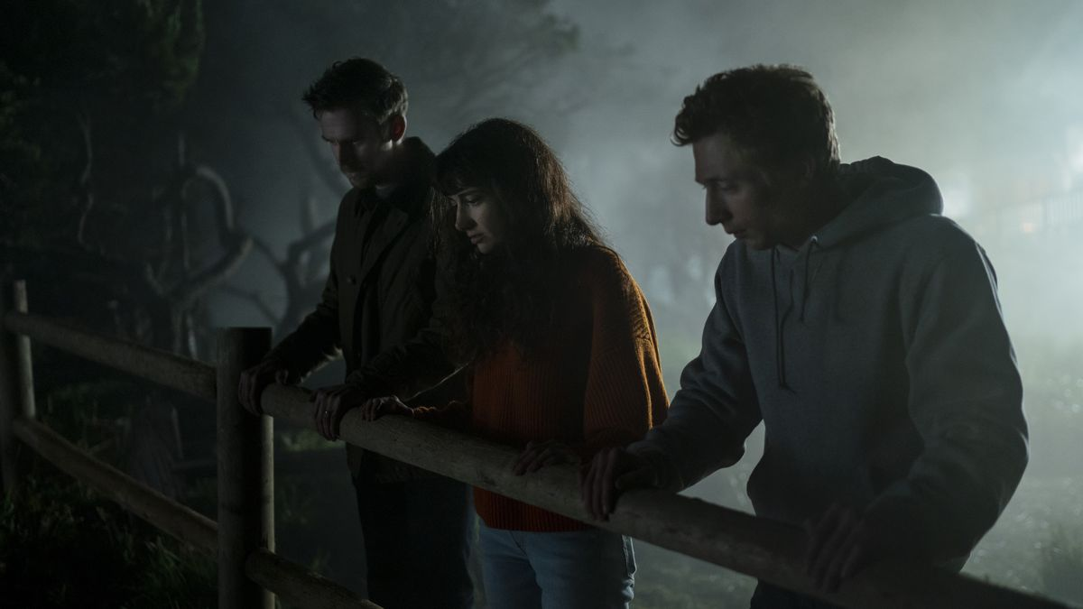 Dan Stevens, Sheila Vand, and Jeremy Allen White look over a fence in a misty scene in Dave Franco's The Rental.