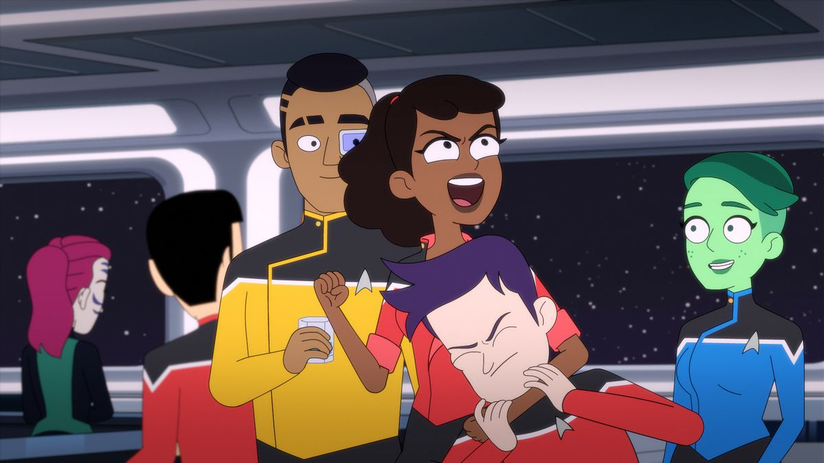 One character in Star Trek: Lower Decks puts another in a headlock as a group of characters stands together in front of a star field.