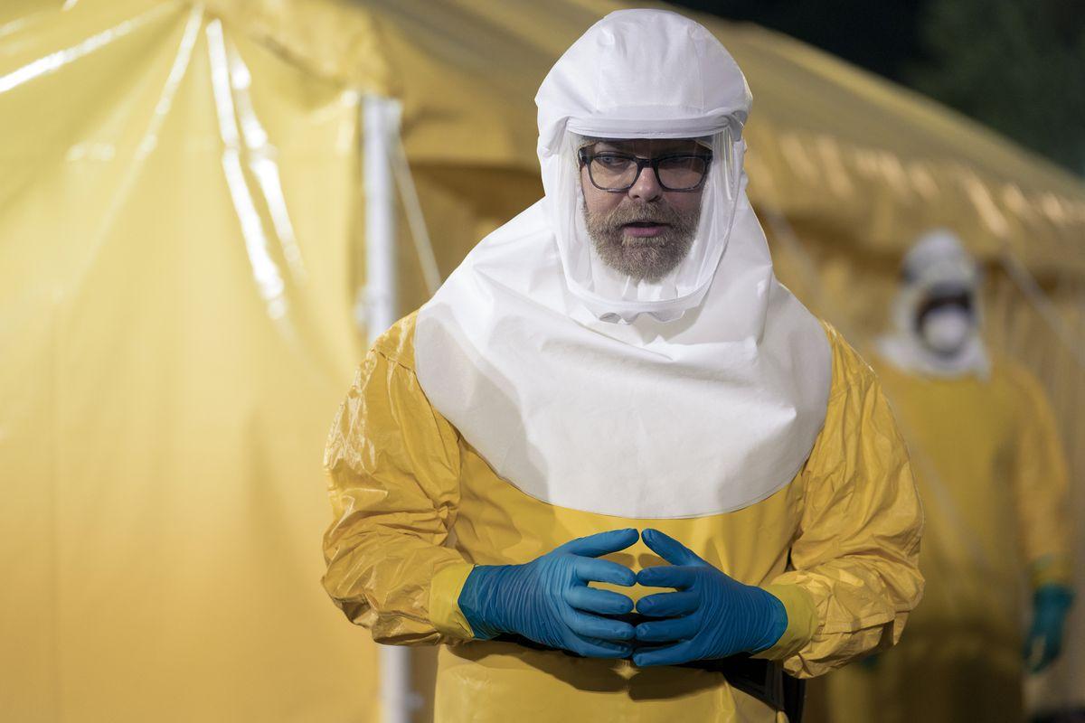 Rainn Wilson in a bright yellow Hazmat suit in Amazon's Utopia