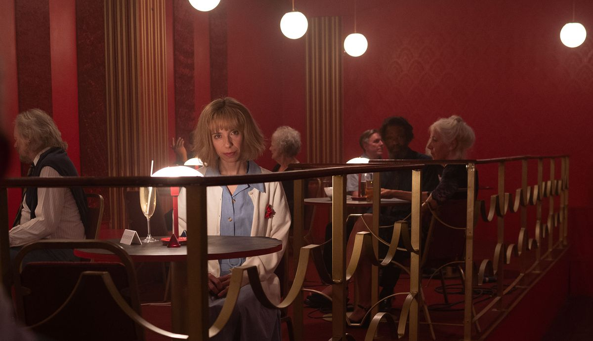 a woman sits alone at a table