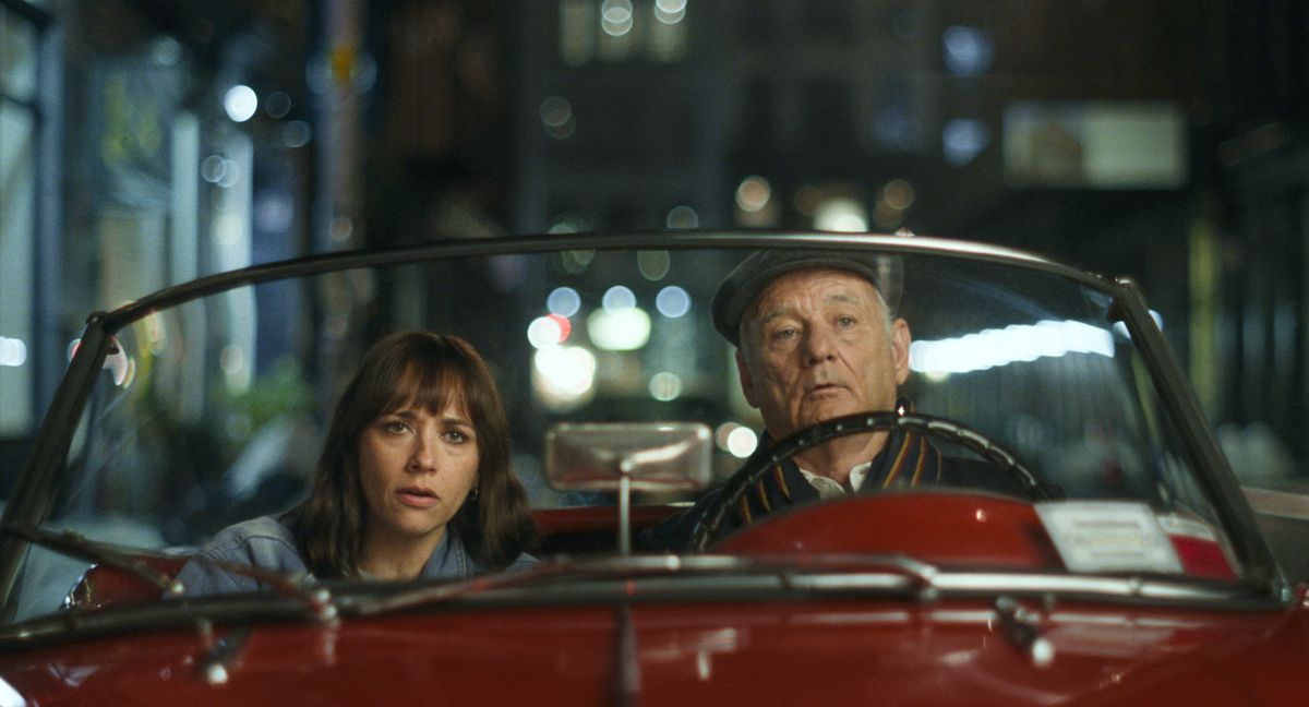 Rashida Jones and Bill Murray drive together at night in a red convertible in On the Rocks
