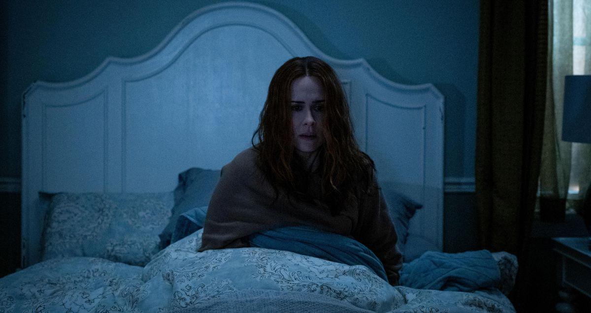Sarah Paulson sits upright in bed in a dark room in Hulu's Run