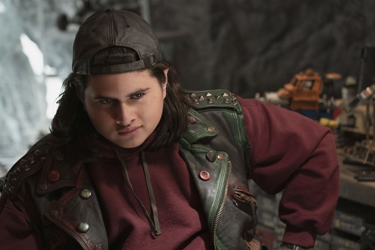 Julian Dennison in Christmas Chronicles 2 does his best evil-elf impression in a leather vest and backward baseball hat