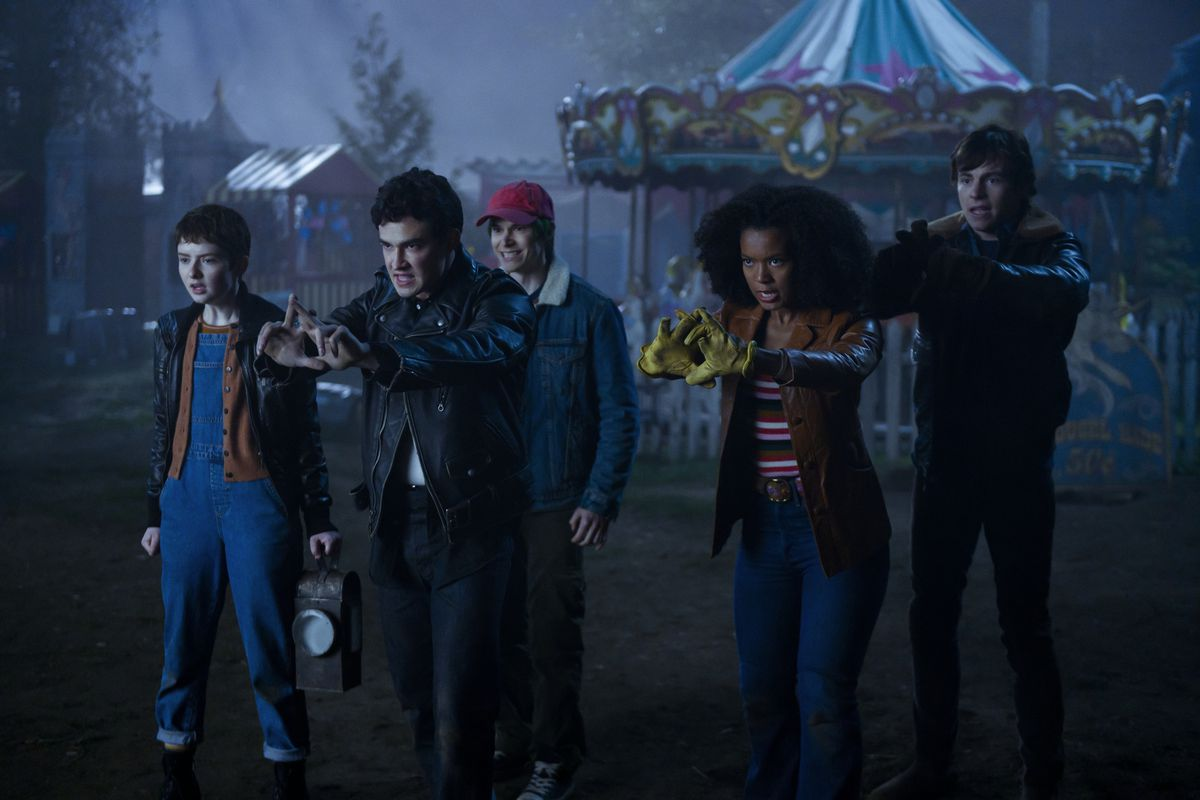 Sabrina's friends gather at a carnival at night, in front of a carousel, in Chilling Adventures of Sabrina