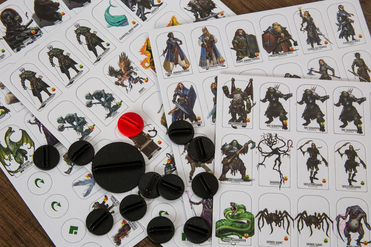 A selection of cardboard tokens, 124 in all, with plastic standees.