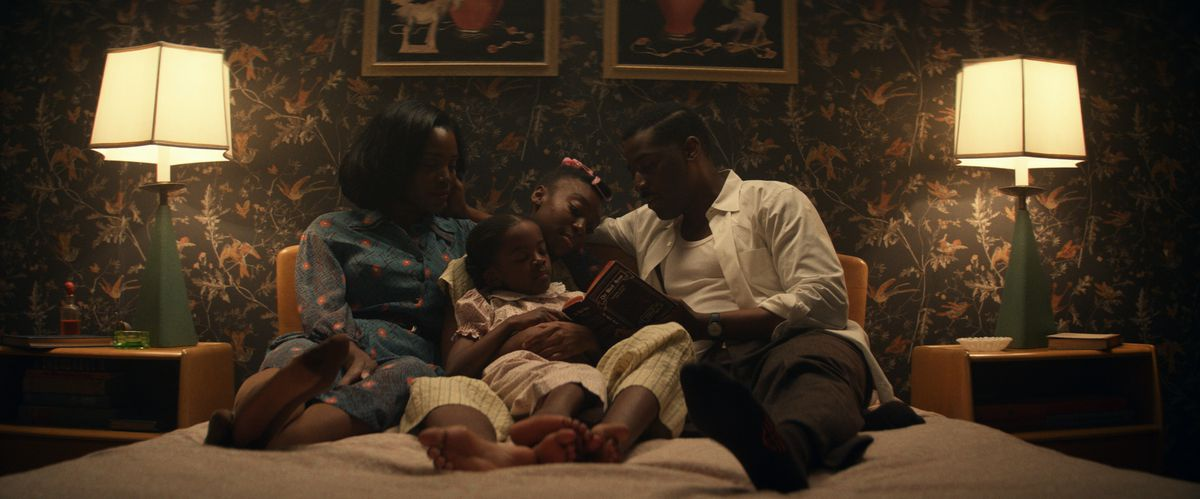 The Emory family curls up together on a bed in Amazon Studios' Them