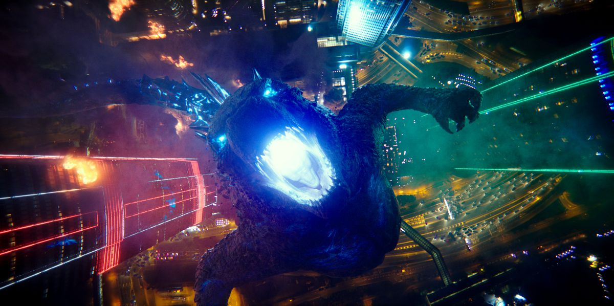 Godzilla seen from above, about to fire his atomic breath skyward in Godzilla vs. Kong