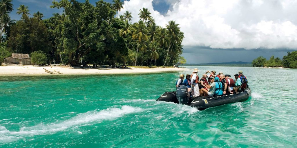 A tour group on a boat with Zegrahm Expeditions