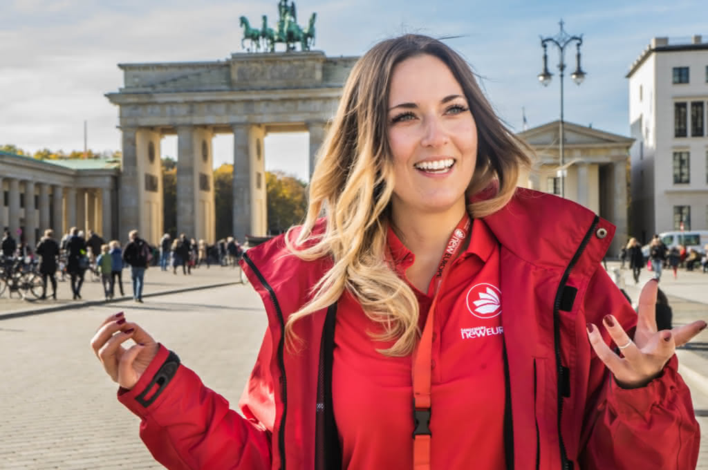 Woman in red jacket giving at walking tour in Germany