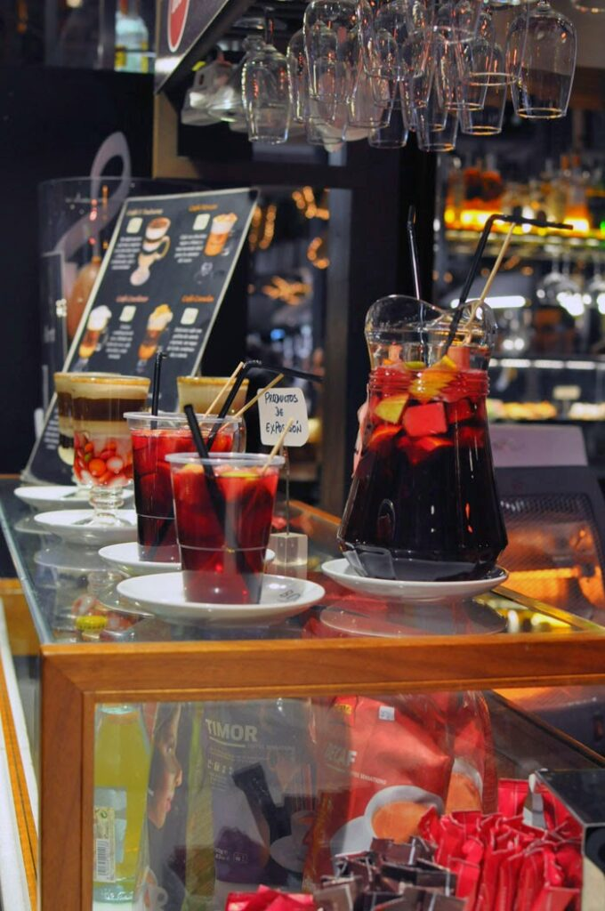 A Jar and several glasses of Sangria in one of Madrid's many food markets