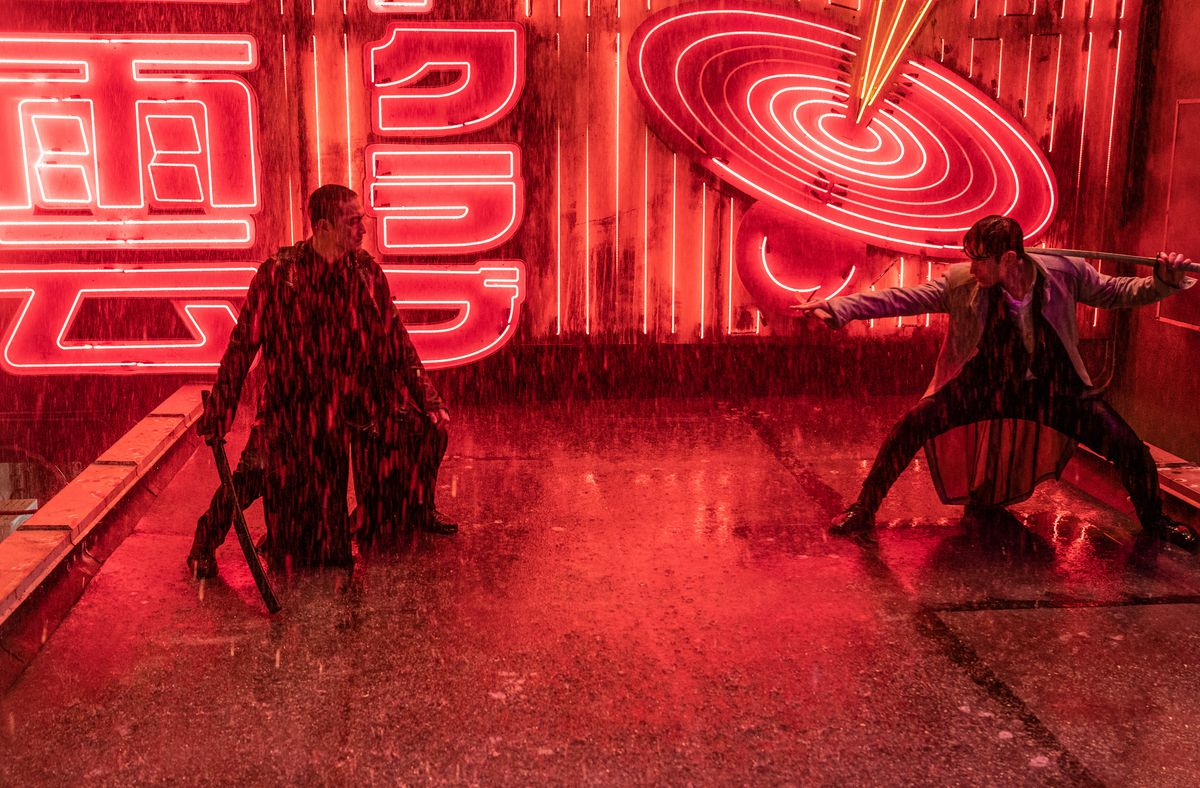 Kenta and Tommy Arashikage face off on a neon-drenched, rainy rooftop in Snake Eyes