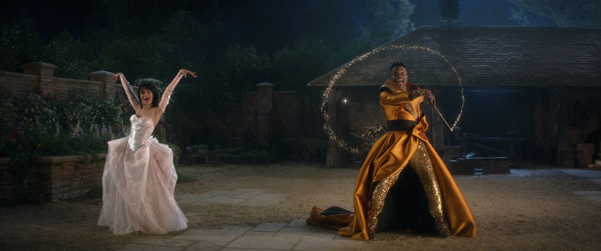 A ballgowned Cinderella (Camila Cabello) and her Fabulous Godmother (Billy Porter) dance outside in Amazon's Cinderella