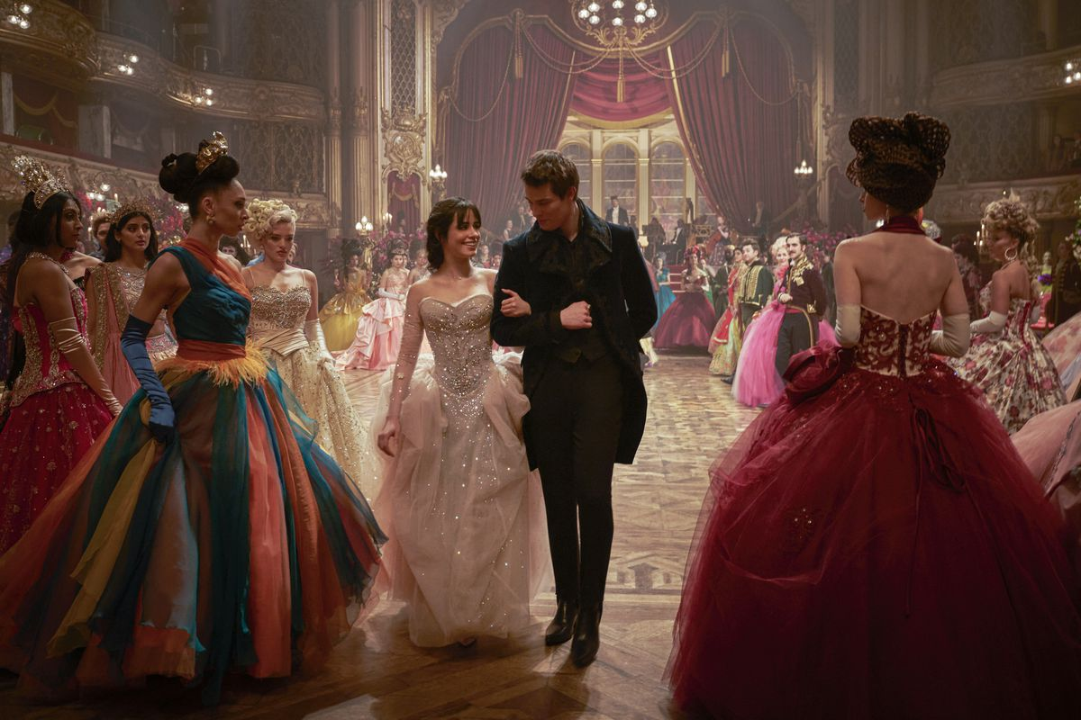 Cinderella (Camila Cabello) and her prince arm in arm at the ball
