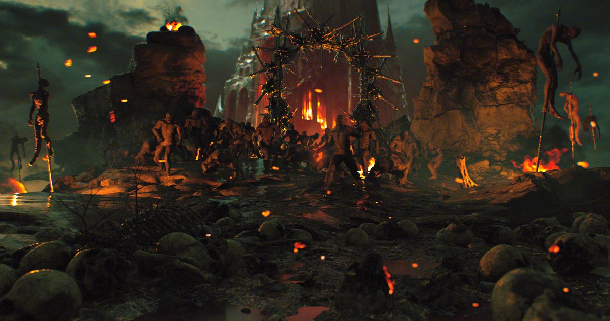 A weird hellscape in Behemoth, with impaled naked corpses, scattered rocks and skulls, and indistinct figures