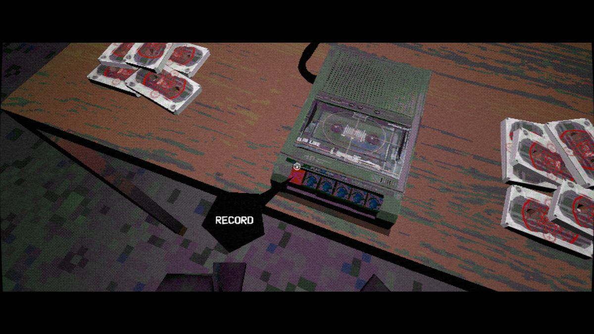 Nightslink - the player prepares to record a cassette in a darkened room