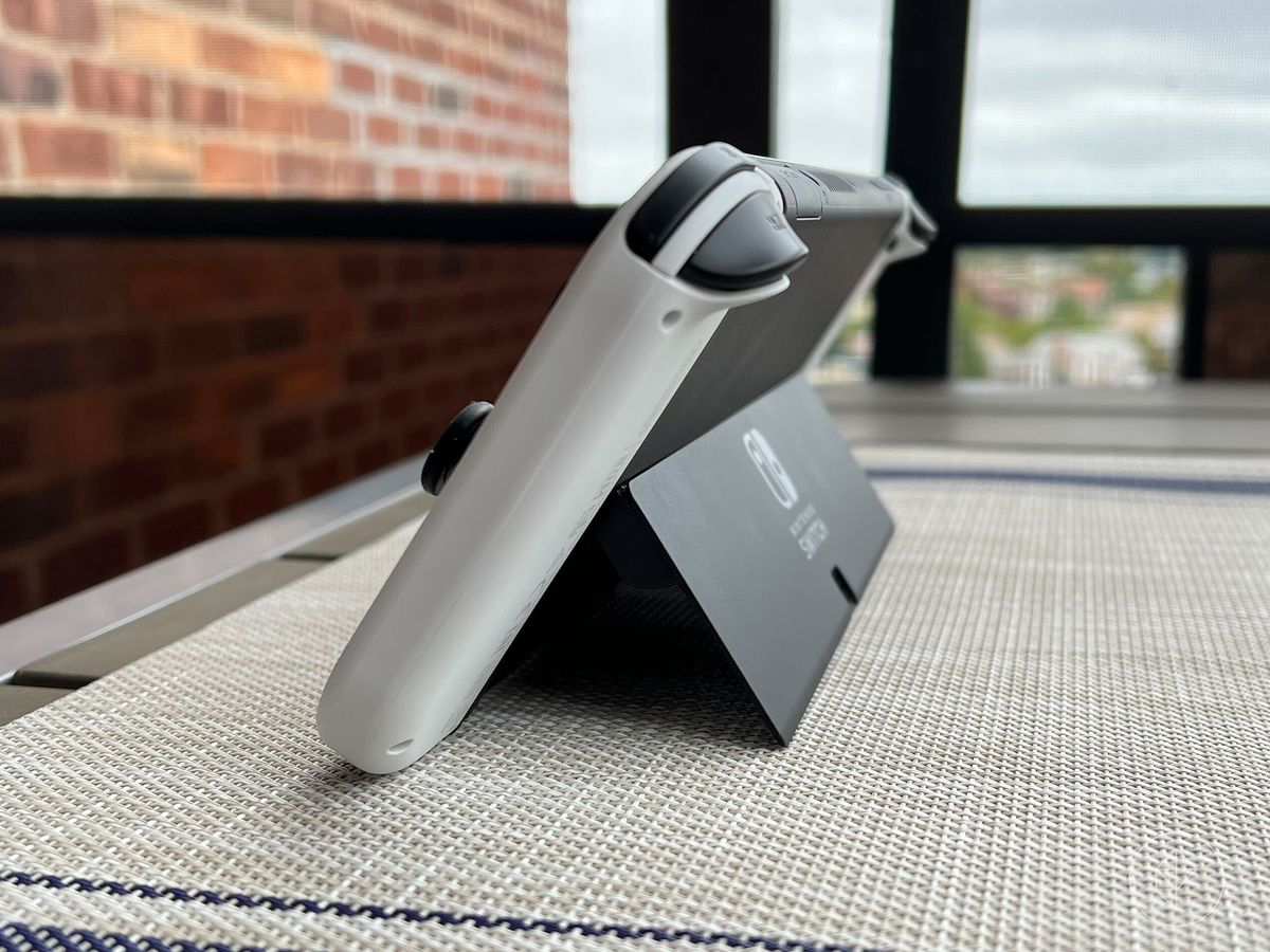 a photo of the side of the Switch OLED, showing the full-width kickstand