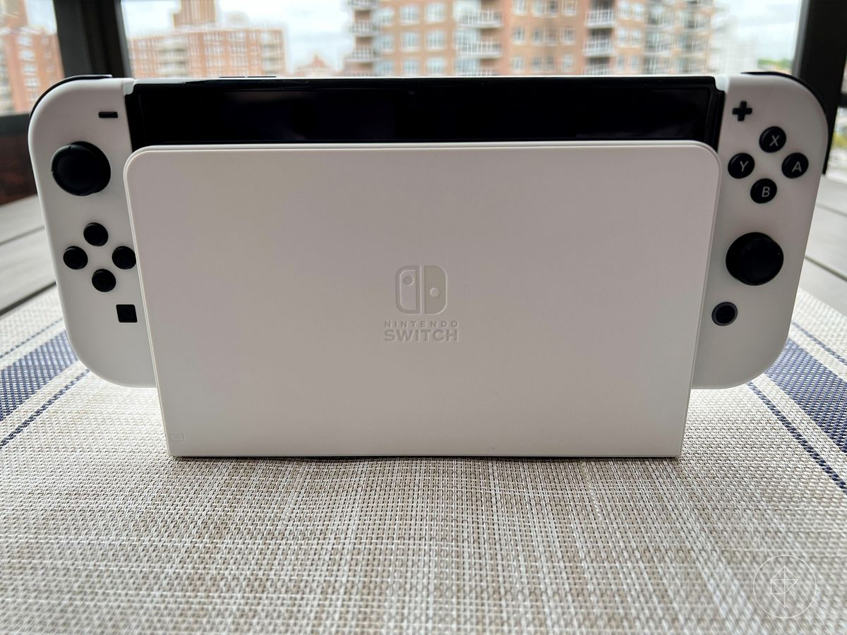 a photo of the white OLED Switch in its white dock